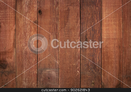 red weathered barn wood  stock photo, red weathered barn wood background with knots and nail holes by Marek Uliasz