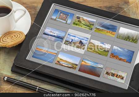 Colorado  pictures on digital tablet stock photo, reviewing image library (grid of thumbnails) on a digital tablet computer -colorful Colorado, lakes and mountains, all displayed pictures copyright by the photographer by Marek Uliasz