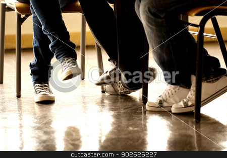 teenager legs stock photo, View of some teenager legs on a classroom. by Mauro Rodrigues