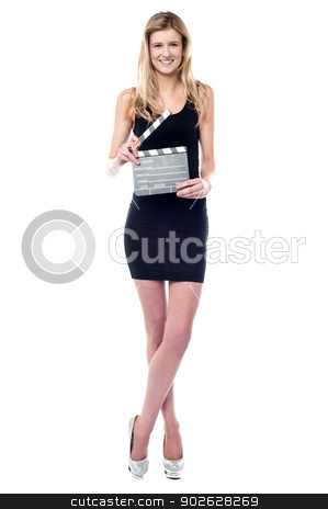 Get ready for next scene... stock photo, Young girl posing with clapperboard by Ishay Botbol
