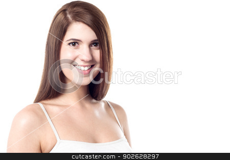 Young attractive female model stock photo, Cute female posing with radiant smile by Ishay Botbol