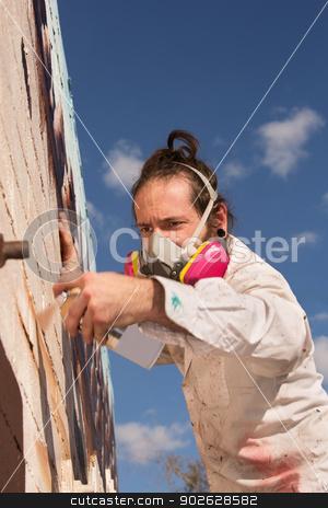 Aerosol Artist Painting stock photo, European man creating spray painting art on wall by Scott Griessel