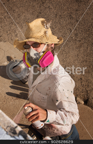 Anonymous Graffit Artist stock photo, Person with hat and sunglasses spray painting a wall by Scott Griessel