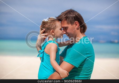Portrait of a little girl kissing a dad in the nose stock photo, Portrait of a little girl kissing a dad in the nose by Dmitry Travnikov