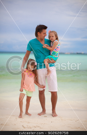 Happy father with his two daughters on tropical beach vacation stock photo, Happy father with his two daughters on tropical beach vacation by Dmitry Travnikov