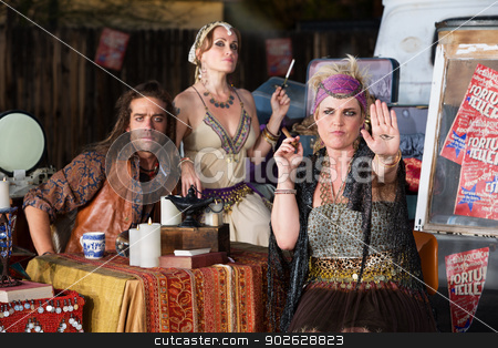 Lady Showing the Evil Eye stock photo, Blond female fortune teller displaying an evil eye in her palm by Scott Griessel