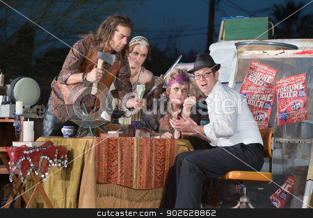 Fortune Teller Threatening Businessman stock photo, Businessman threatened by angry fortune tellers at table by Scott Griessel