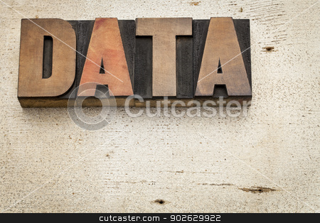 data word in wood type stock photo, data word in vintage letterpress wood type on a grunge painted barn wood background by Marek Uliasz