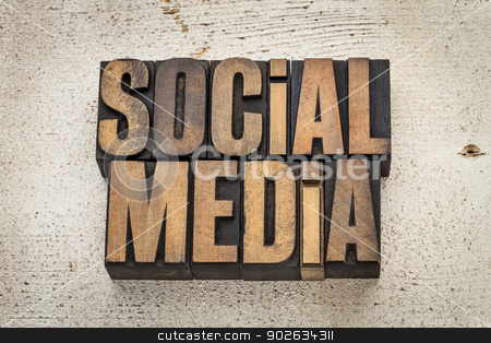 social media in wood type stock photo, social media phrase in vintage letterpress wood type on a grunge painted barn wood background by Marek Uliasz