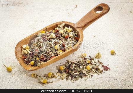 scoop of herbal tea stock photo, organic herbal tea (chamomile, peppermint,,orange peel, rose hips, hibiscus) - rustic wooden scoop and a pile on rough white painted barn wood by Marek Uliasz