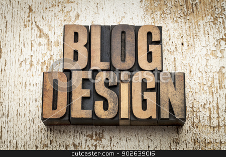 blog design in wood type stock photo, blog design word in vintage letterpress wood type on a grunge painted barn wood background by Marek Uliasz