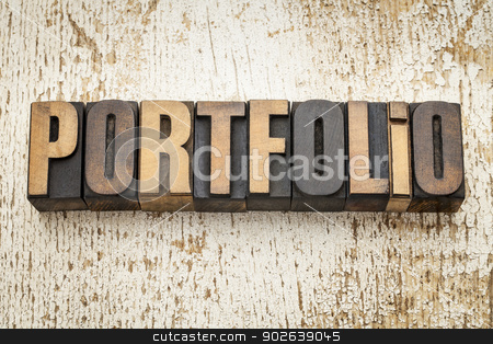 portfolio word in wood type stock photo, portfolio word in vintage letterpress wood type on a grunge painted barn wood background by Marek Uliasz