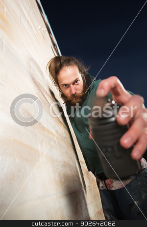 Man Holding Spray Can Close stock photo, Close up of spray paint can held by graffiti artist by Scott Griessel