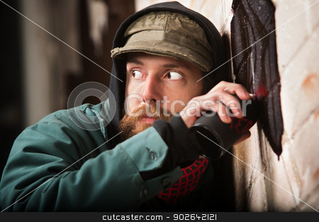 Worried Graffiti Artist stock photo, Worried grafitti artist looking over his sholder by Scott Griessel