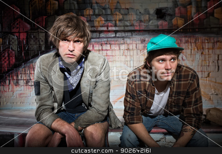 Pair of Homeless Teens stock photo, Pair of European homeless youth sitting on bench by Scott Griessel