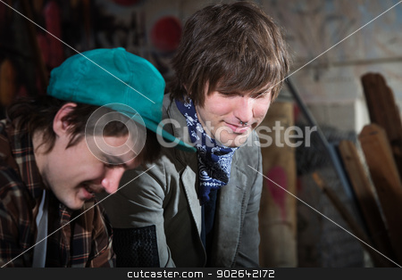 Unemployed Youth stock photo, Smiling teen friends sitting in urban scene outdoors by Scott Griessel