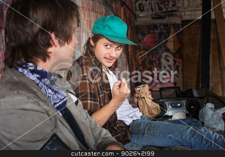 Homeless Teens Talking stock photo, Two homeless teenagers with brown paper bag talking by Scott Griessel