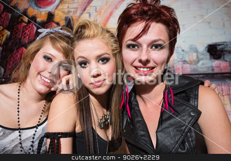 Three Smiling Friends stock photo, Three smiling Caucasian teenage friends near graffiti wall by Scott Griessel