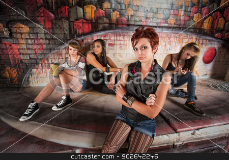 Girl Bored with Friends stock photo, Disappointed teenager with indifferent friends behind her by Scott Griessel