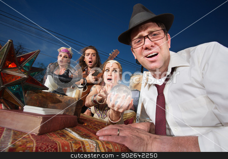 Distressed Man's Future stock photo, Distressed businessman sitting at a fortune teller table outside by Scott Griessel