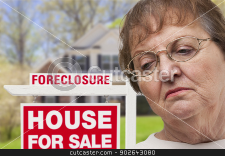 Depressed Senior Woman in Front of Foreclosure Real Estate Sign stock photo, Depressed Senior Woman in Front of Foreclosure Real Estate Sign and House. by Andy Dean