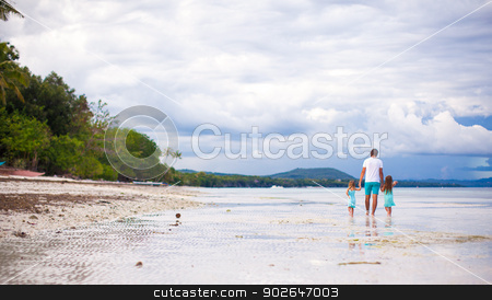 Panorama of father with his young daughters walking along the sea stock photo, Panorama of father with his young daughters walking along the sea by Dmitry Travnikov