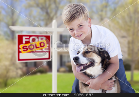 Young Boy and His Dog in Front of Sold For Sale Sign and House stock photo, Happy Young Boy and His Dog in Front of Sold For Sale Real Estate Sign and House. by Andy Dean