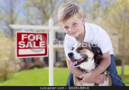 Young Boy and His Dog in Front of For Sale Sign and House stock photo, Happy Young Boy and His Dog in Front of For Sale Real Estate Sign and House. by Andy Dean