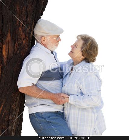 Happy Senior Couple Leaning Against Tree on White stock photo, Affectionate Loving Senior Couple Leaning Against Tree Isolated on White. by Andy Dean