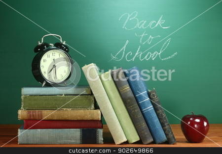 School Books, Apple and Clock on Desk at School stock photo, Back to School Books, Apple and Clock on Desk by Katrina Brown