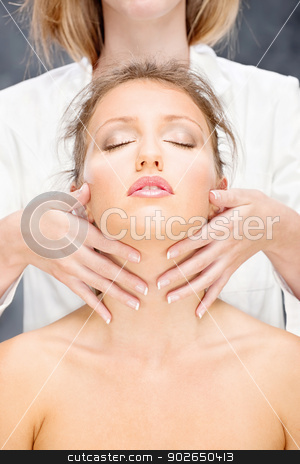 woman on head massage stock photo, Pretty woman on head massage treatment by iMarin