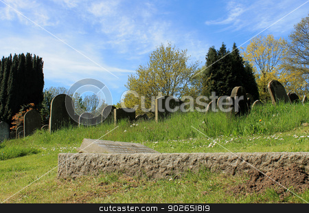 Old grave in cemetery stock photo, Scenic view of old graves in cemetery, England. by Martin Crowdy