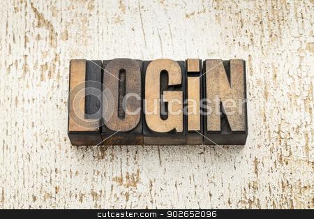 login word in wood type stock photo, login word in vintage letterpress wood type on a grunge painted barn wood background by Marek Uliasz