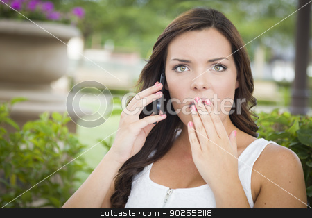 Shocked Young Adult Female Talking on Cell Phone Outdoors stock photo, Shocked Young Adult Female Talking on Cell Phone Outdoors on Bench. by Andy Dean