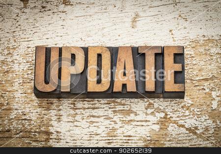update word in wood type stock photo, update word in vintage letterpress wood type on a grunge painted barn wood background by Marek Uliasz