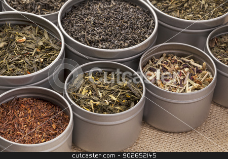green,  black and red tea stock photo, samples of loose leaf green, red, black and herbal tea in metal cans on canvas background by Marek Uliasz