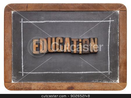 education word in wood type stock photo, education word in vintage letterpress wood type against old slate blackboard by Marek Uliasz