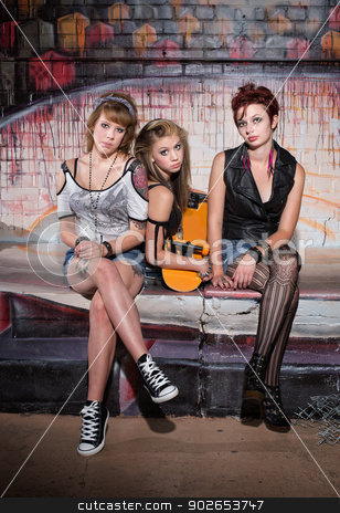 Serious Girls with Skateboard stock photo, Trio of beautiful young women with skateboard by Scott Griessel