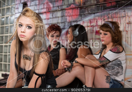Girls Ignoring Young Teen stock photo, Girls ignoring sad blond young woman outside by Scott Griessel
