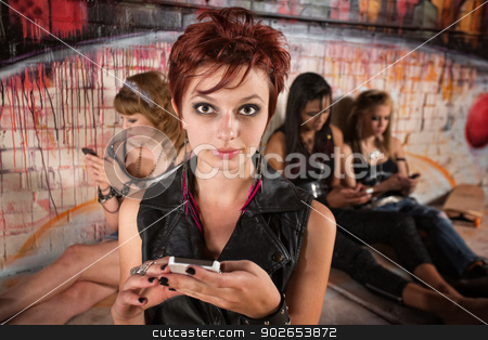 Serious Ladies with Phones stock photo, Serious young white female with phone near friends by Scott Griessel