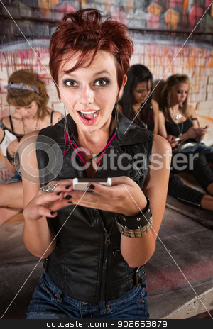 Surprised Lady with Phone stock photo, Surprised pretty young woman holding a smart phone by Scott Griessel