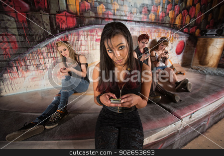 Hispanic Female Using Phone stock photo, Beautiful Hispanic female teenager using cell phone by Scott Griessel