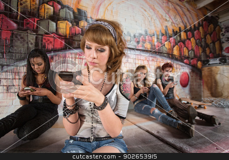 Serious Teen on Phone stock photo, Serious young European woman using her telephone by Scott Griessel