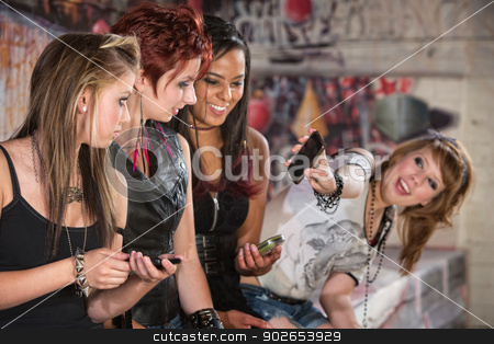 Teen Showing Her Phone stock photo, Teenager showing group of pretty friends her phone by Scott Griessel