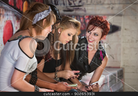Smiling Teens with Phones stock photo, Smiling teenage female showing off her cell phone by Scott Griessel