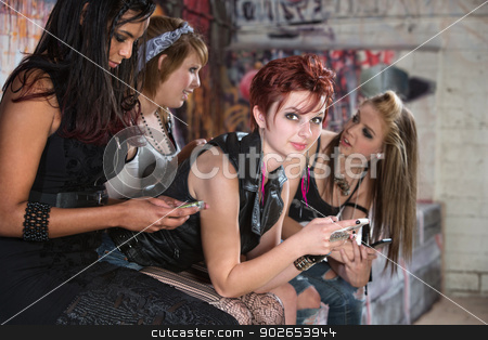 Smiling Pretty Teens with Phones stock photo, Beautiful Caucasian teenager and friends with phones by Scott Griessel