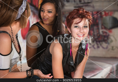Pleasant Young Woman with Friends stock photo, Pleasant young woman sitting with friends talking by Scott Griessel