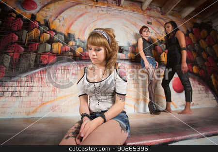 Ashamed Woman Sitting Alone stock photo, Ashamed young woman in shorts sitting alone by Scott Griessel