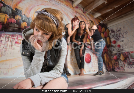 Woman with Hand on Face stock photo, Young woman with hand on face near group by Scott Griessel