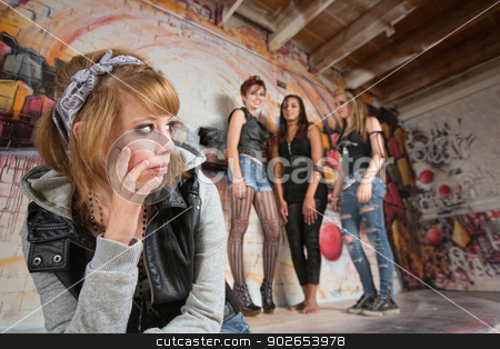 Insulted Girl Looking Over stock photo, Insulted blond teenager looking over at group of girls by Scott Griessel